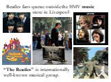 "Beatles fans queue outside the HMV music store in Liverpool. ""The Beatles"" is internationally well-known musical group."